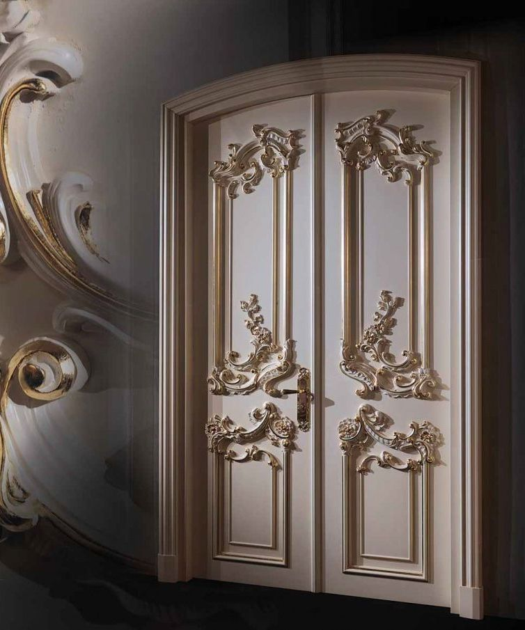 Luxury white door in baroque style in a dark room interior for Interior design ideas for main door