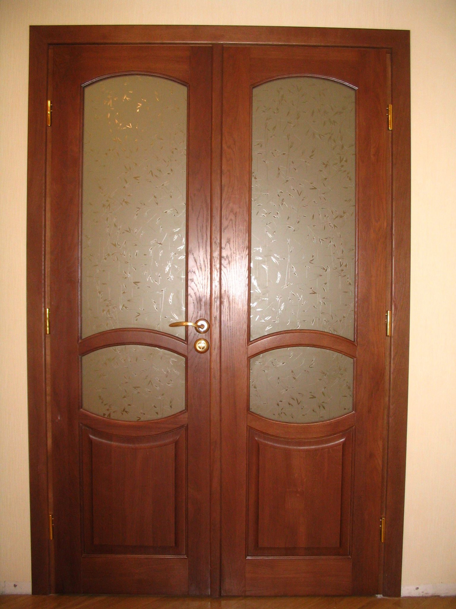 Dark brown masonite two-leaf door with glass