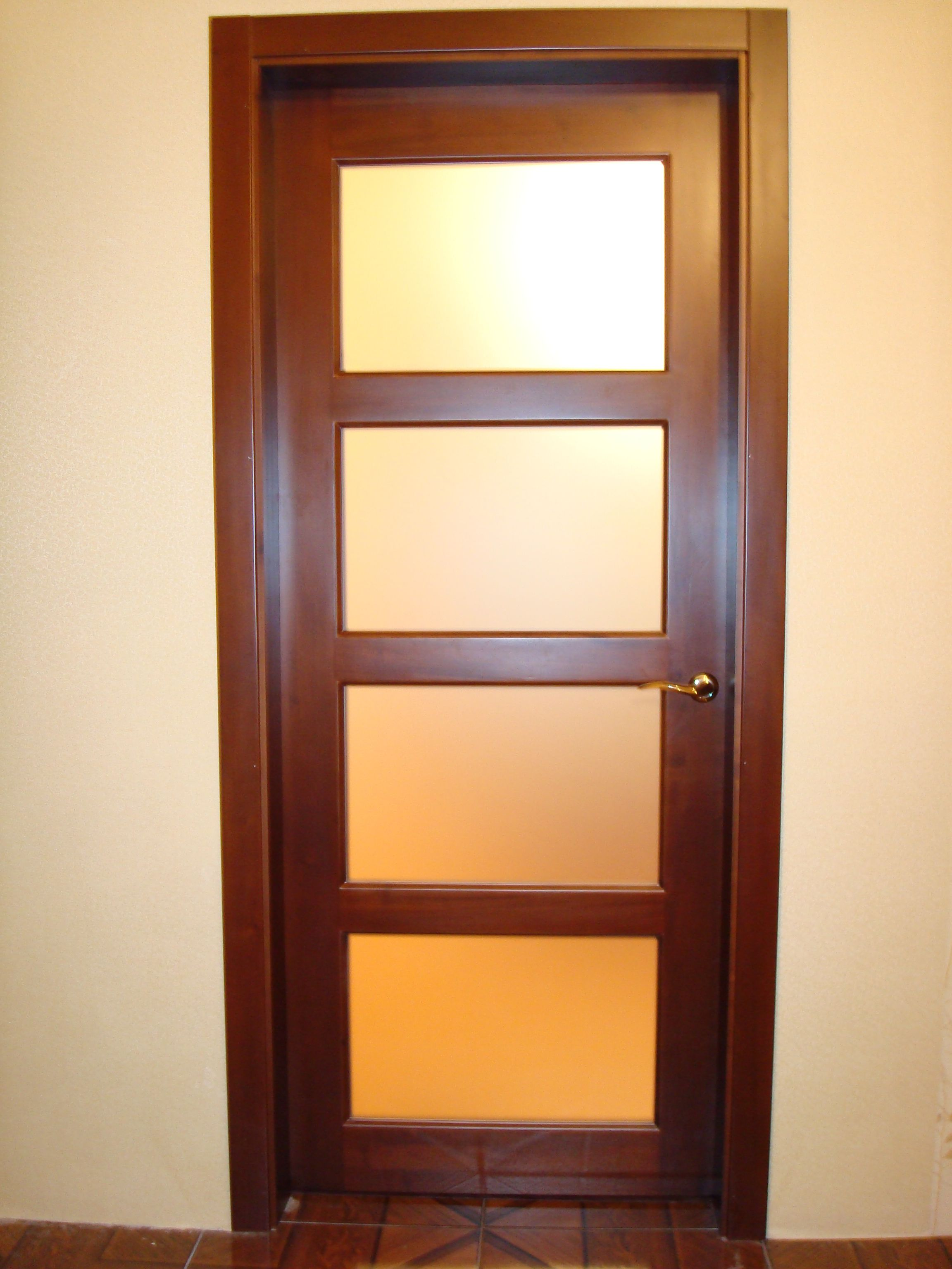 Modern brown wooden door with glass in bright room for Interior glass doors