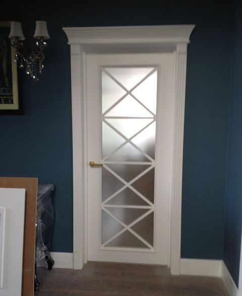 White wooden interior doors with white door frame