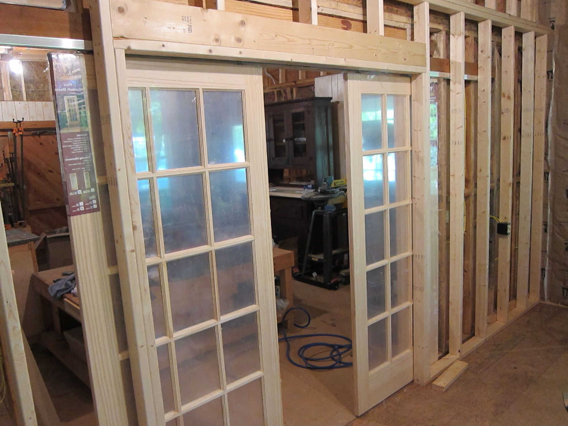 Folding glass and plastic patio doors for Double wood doors with glass