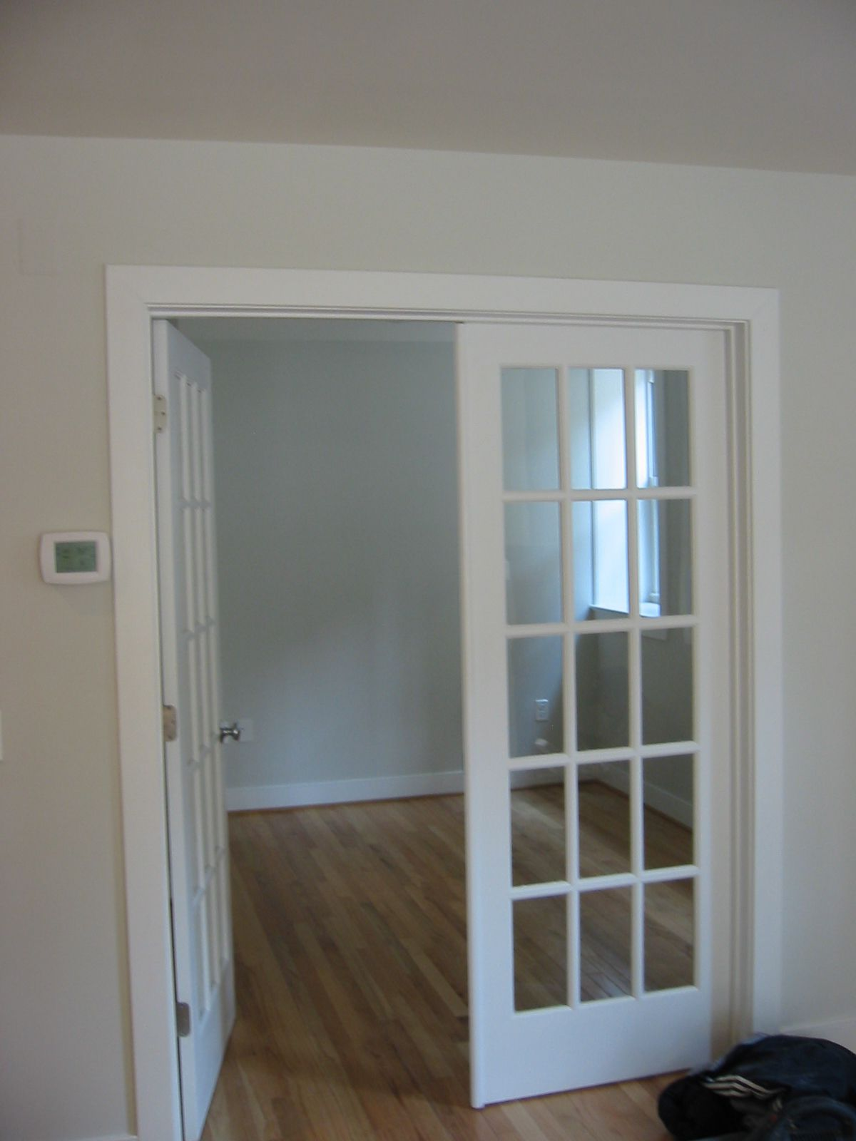 Double-swing white french doors