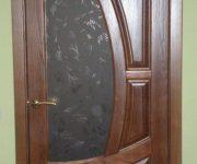 Hinged wooden door in the apartment