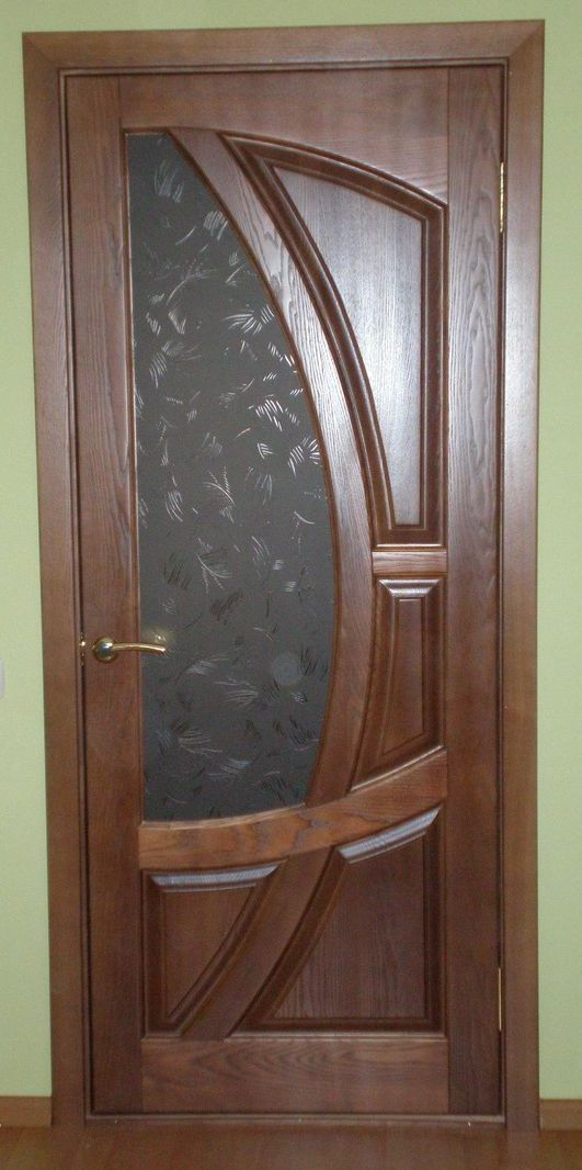 Hinged wooden door in the apartment