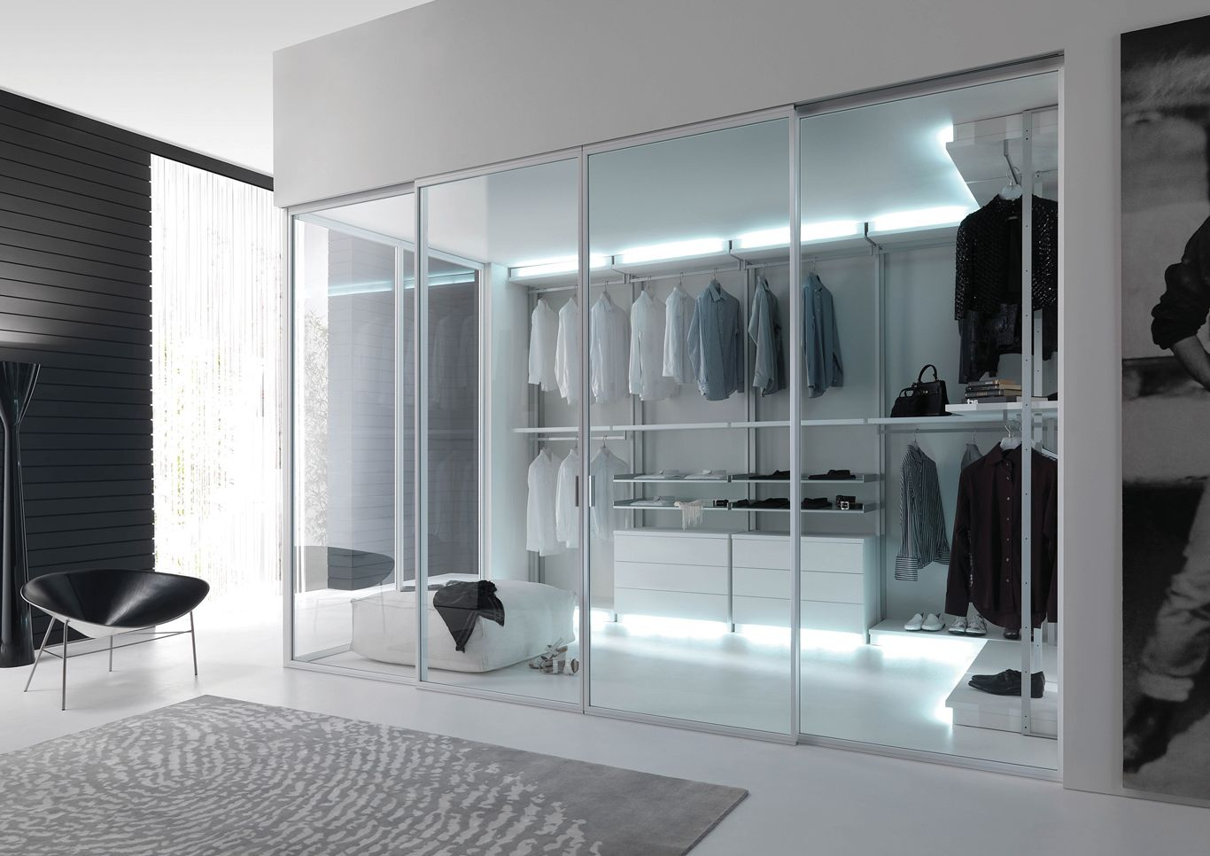 Large wardrobe with glass sliding doors in high-tech style