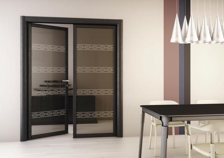 modern dark glass double-swing doors