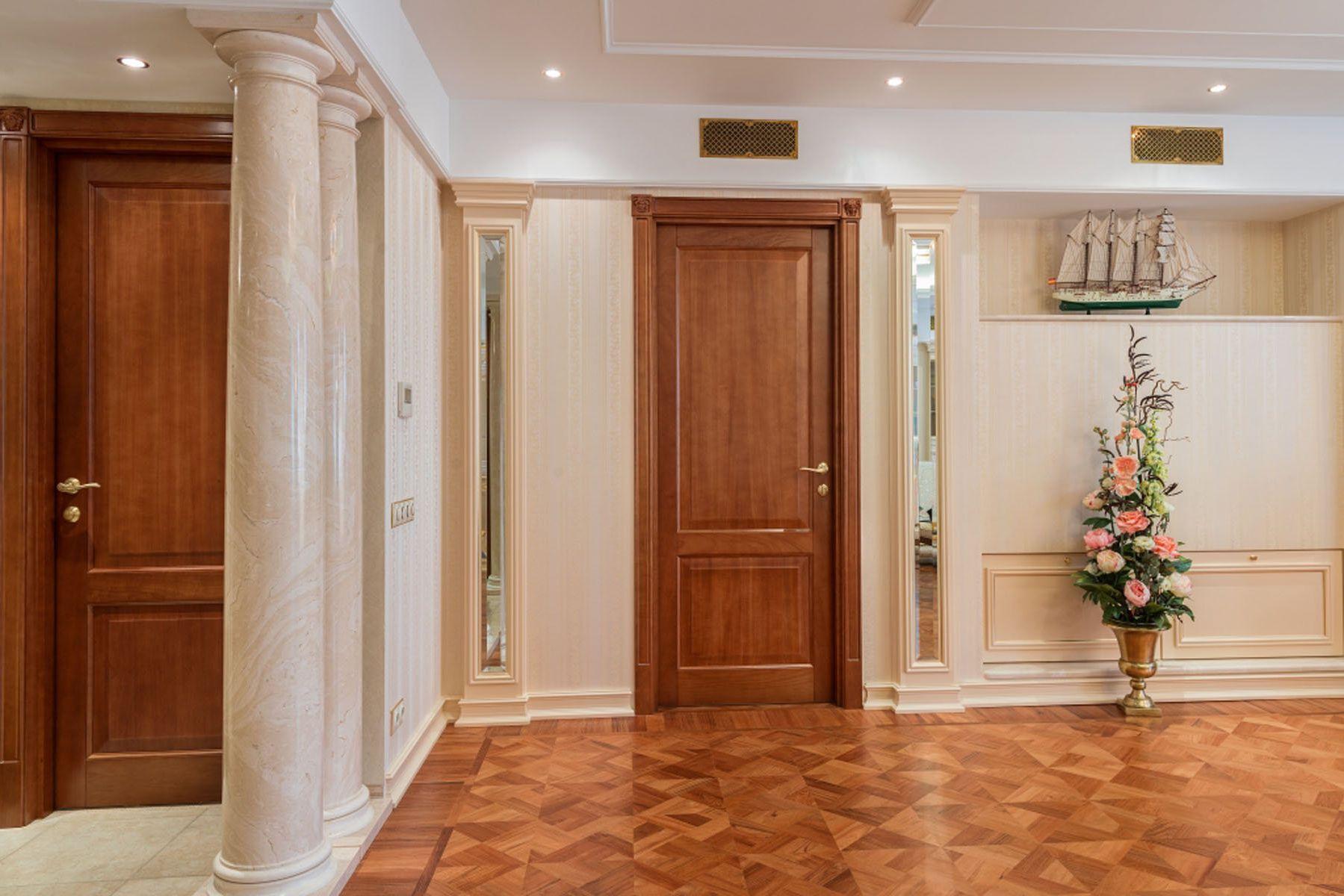 The massive door of solid wood in a classic room design