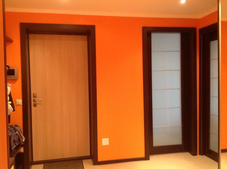 Warm colors of wood with a red tinge interior doors