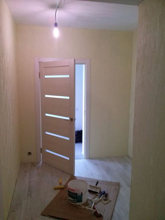 White interior doors in a bright room during the renovation