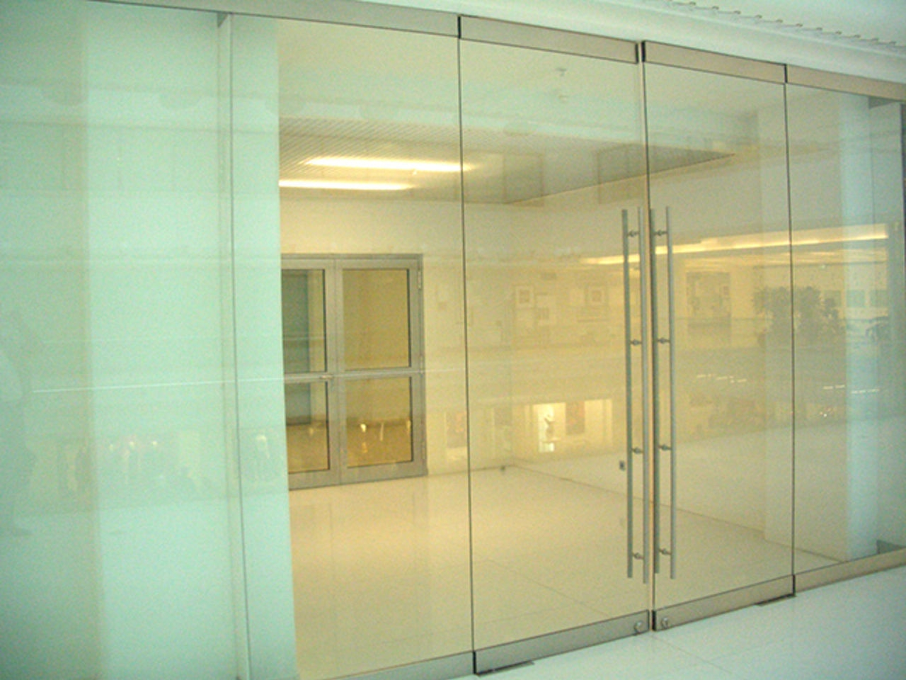 A wall of glass and double swing glass door