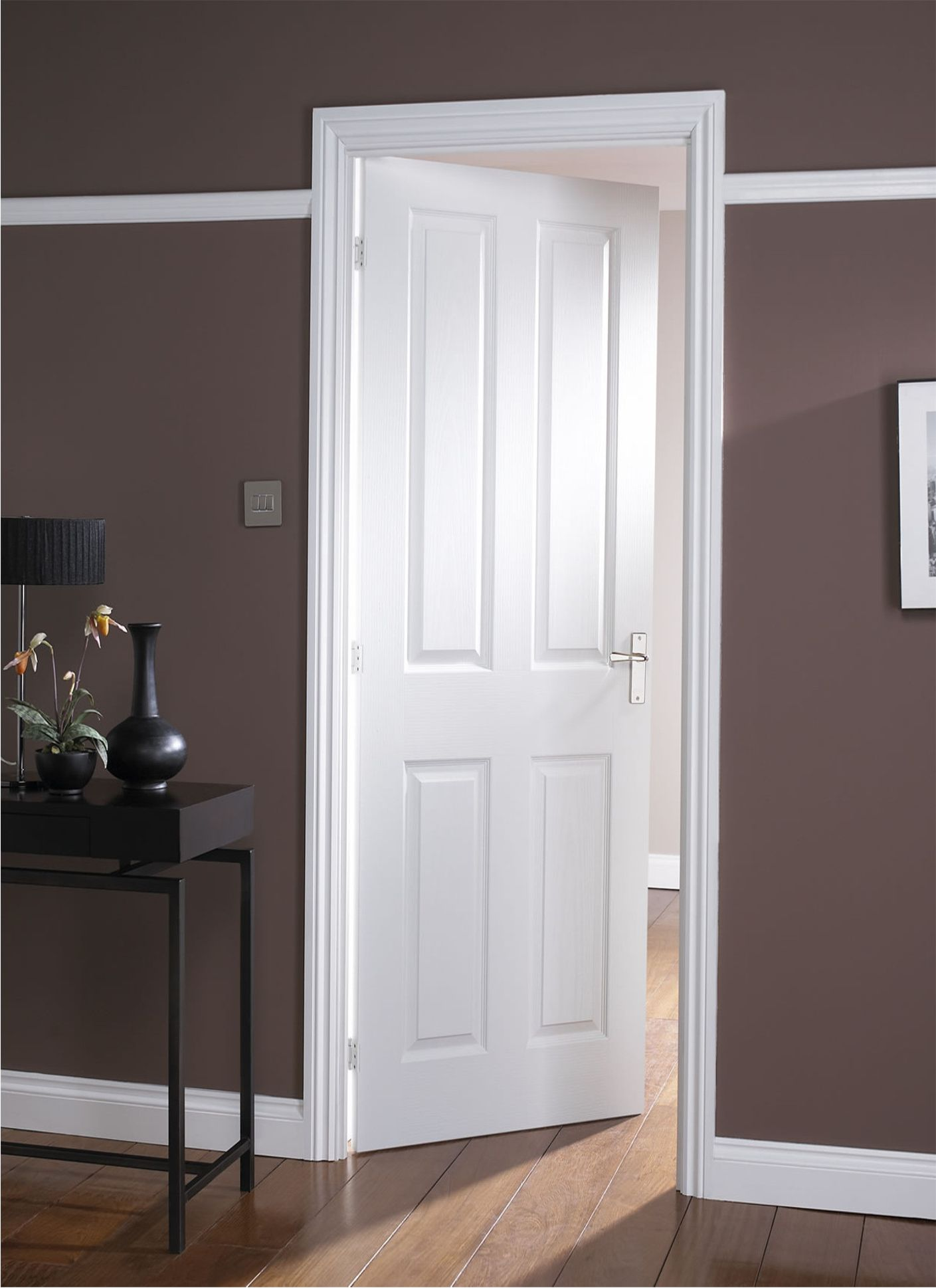 White interior masonite door to a dark room