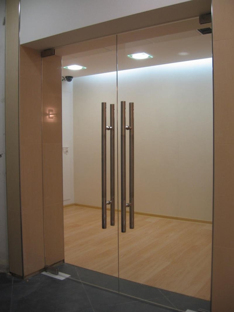 Glass double hinged swinging doors