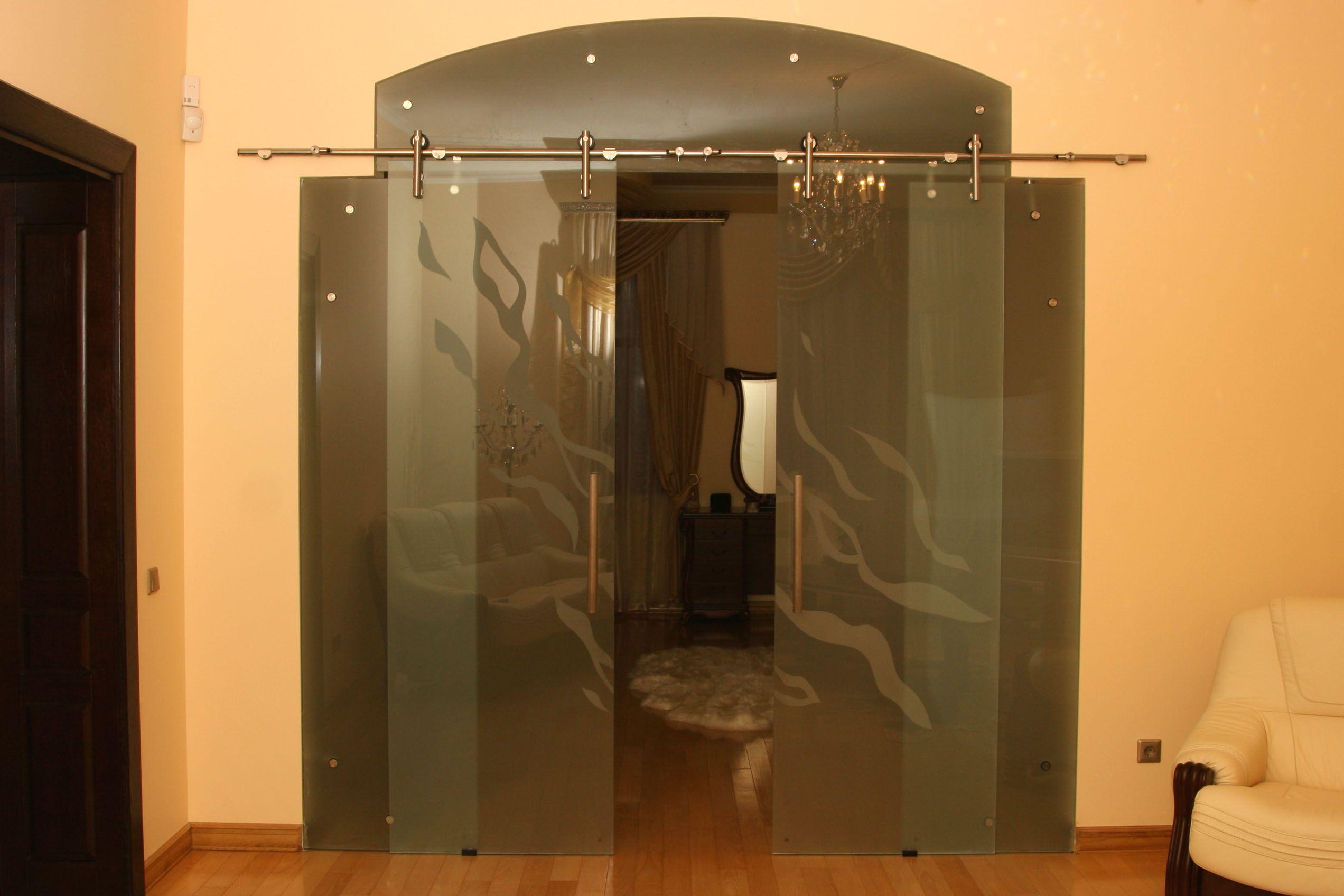 Rolling glass door