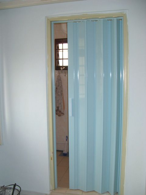 White plastic folding doors