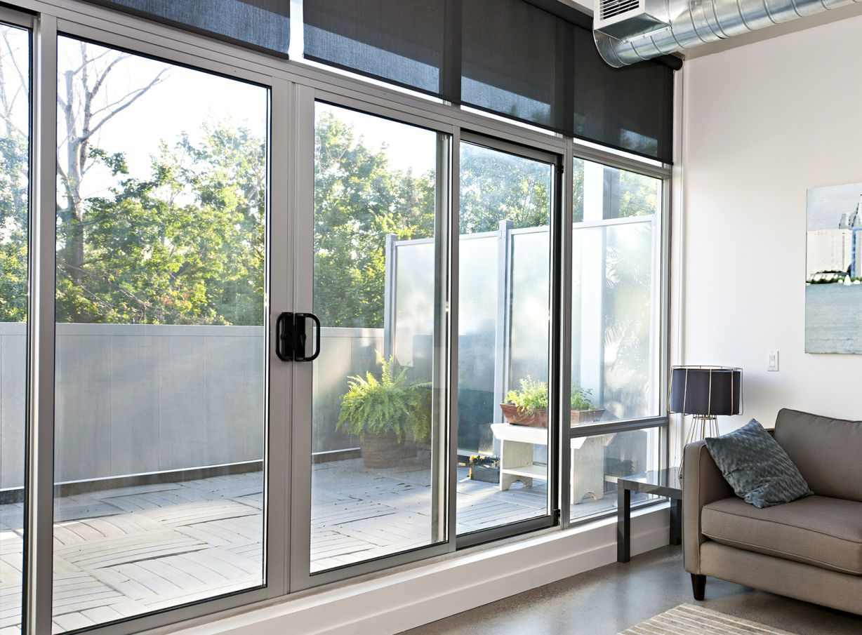 White sliding aluminum door with a large glass for the for Long sliding glass doors