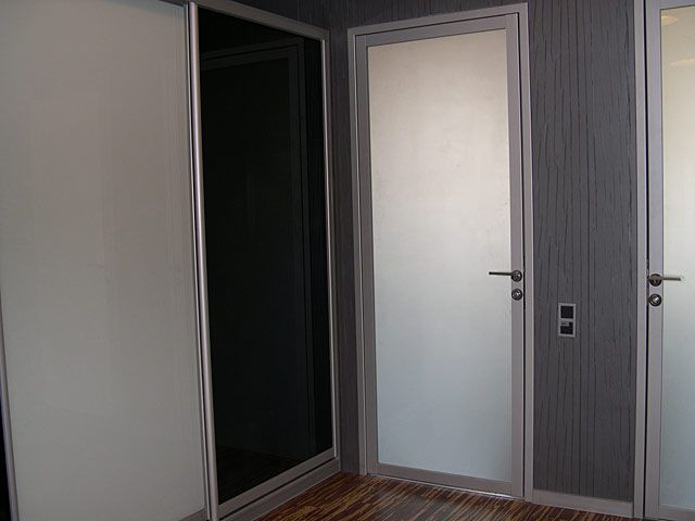 Modern design aluminum interior doors in the apartment
