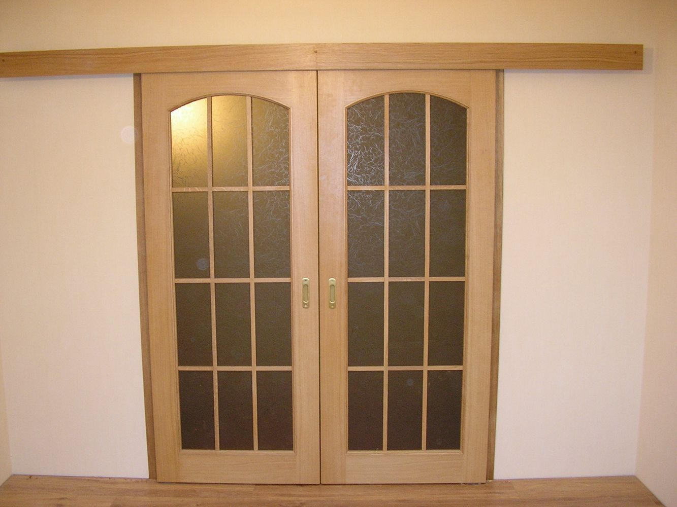 Sliding veneered interior doors