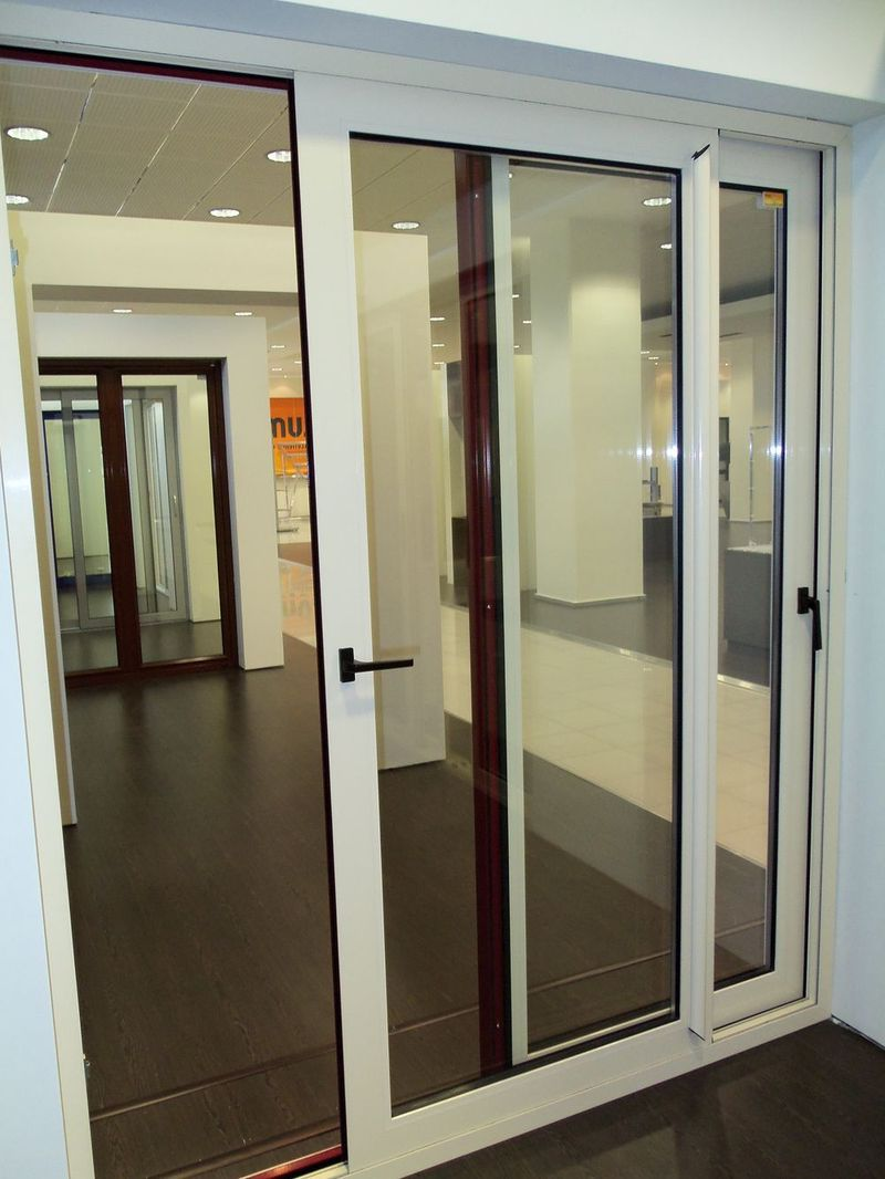 White sliding aluminum door with a large glass for the for Interior sliding glass doors