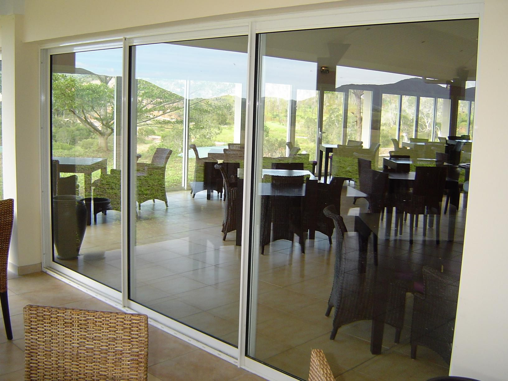 White sliding aluminum door with a large glass for the dining room in the hotel