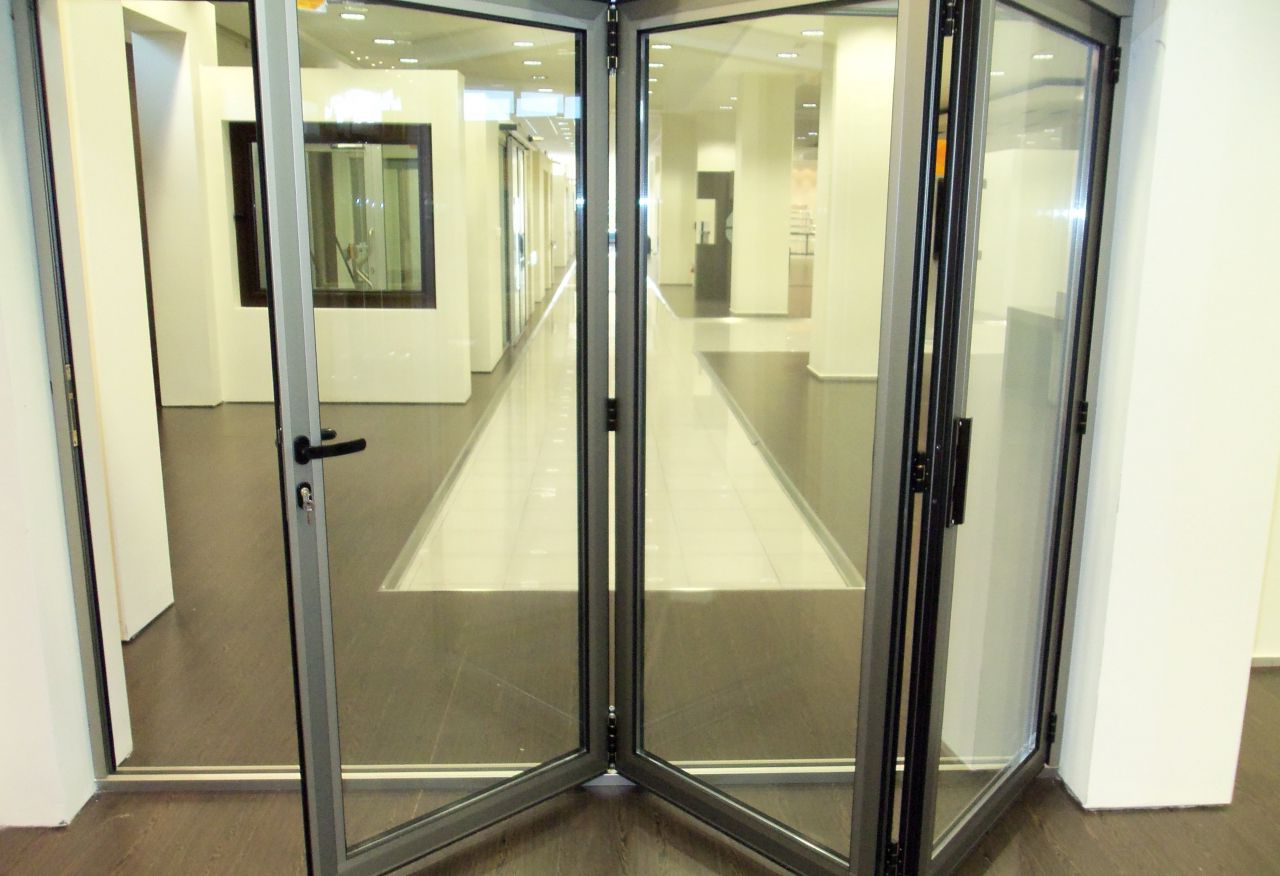 Folding interior aluminum door with glass