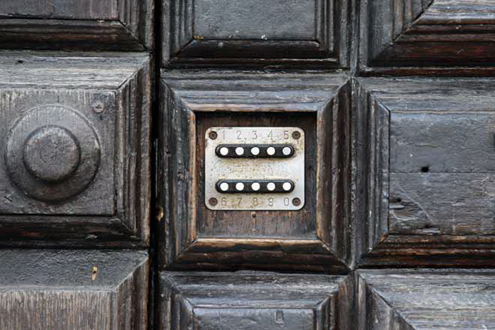 Combination lock on vintage wooden door