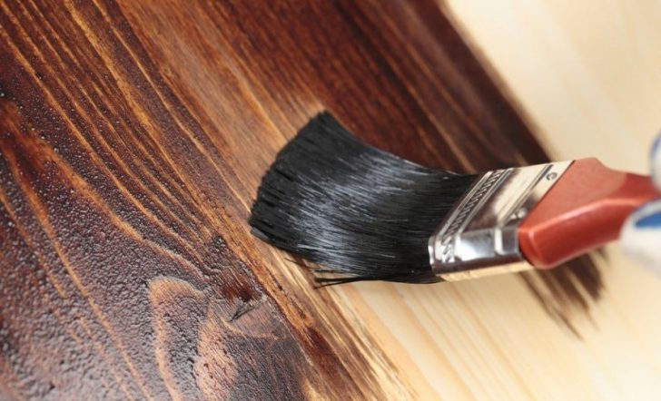 Processing of a wooden cloth wood stain 728x442 - How to paint a door with your own hands