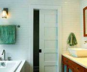 Sliding white door to the bathroom