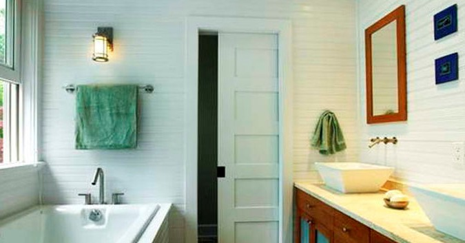Sliding white door to the bathroom