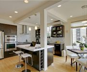 The arch in the kitchen with a Breakfast bar