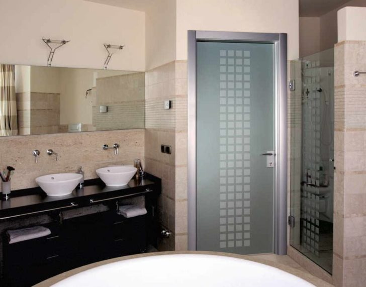 The glass door to the bathroom