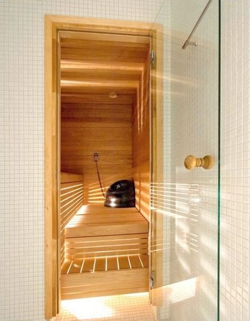 Hinged glass door for saunas