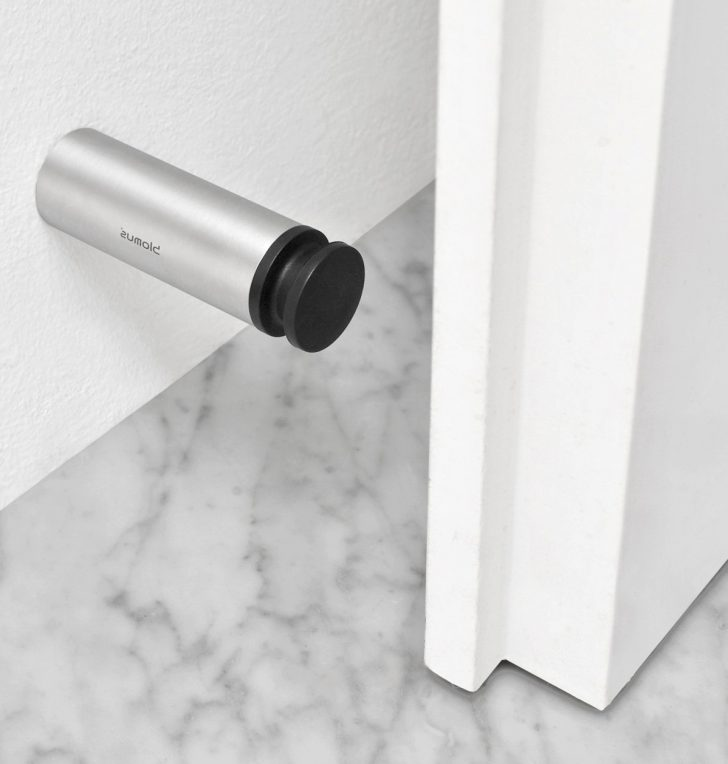 Metal wall holder 728x764 - Door stoppers or holders: functions, types, installation