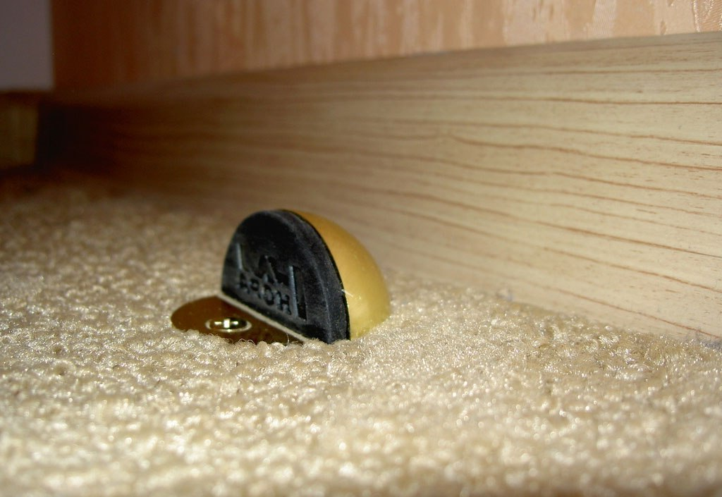 Stationary door stoppers