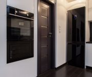Black door in a bright interior design