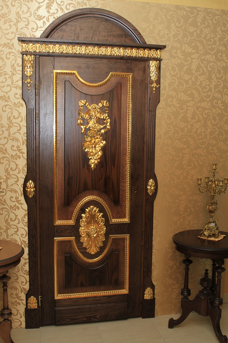 Carved oak doors with gold