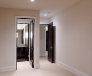 Interior design with black doors and white walls and white floors