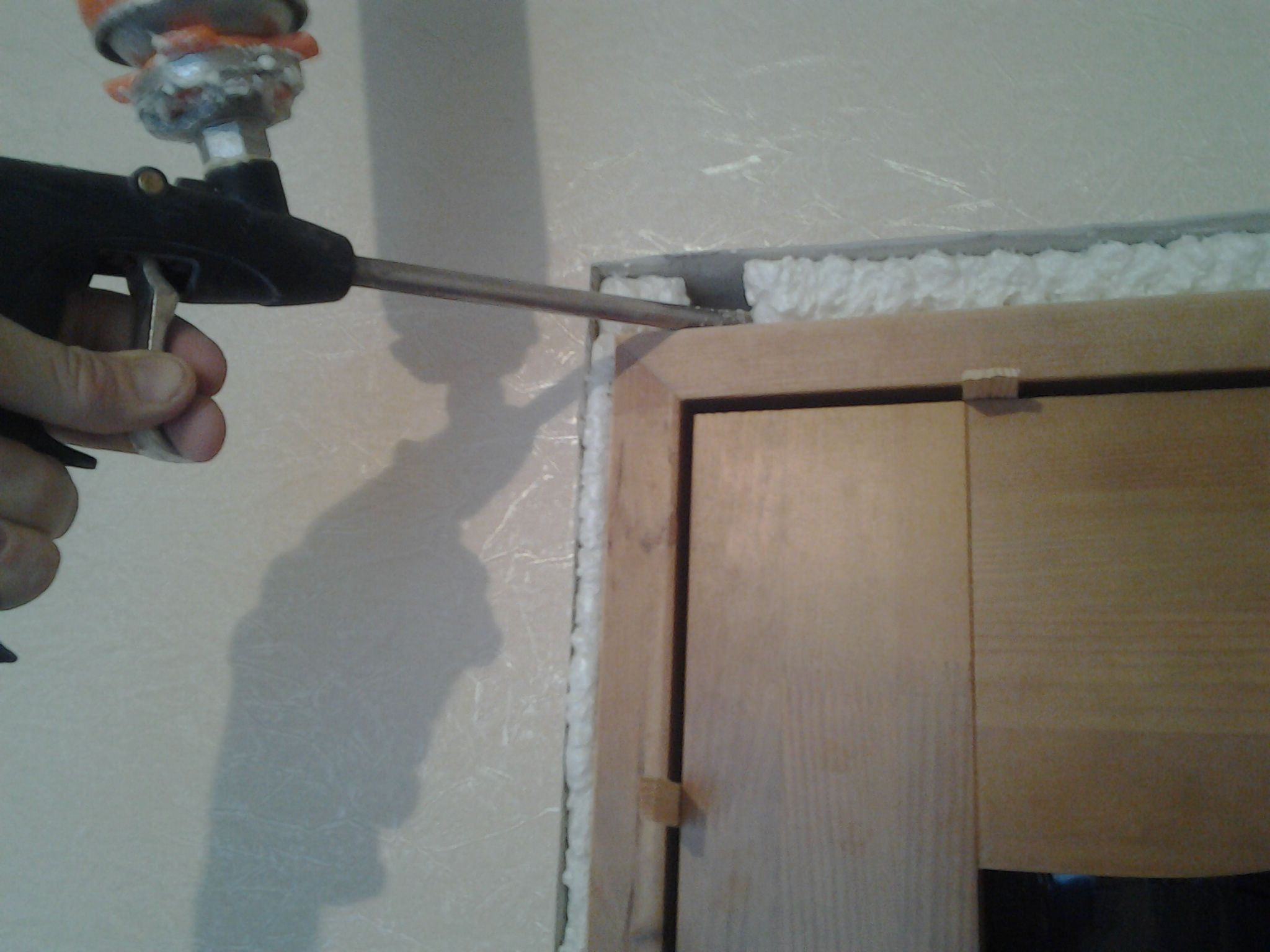 The Foaming Of The Gap Of The Door Frame