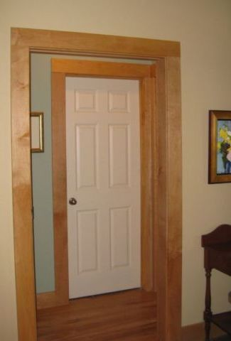 White interior doors with stained wood trim photo for Wood doors painted trim
