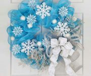 Blue Christmas wreath from tulle and white paper snowflakes