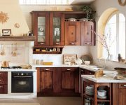 Cabinets made of natural wood in the kitchen in the Italian style