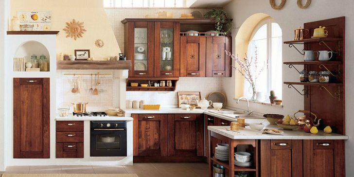Cabinets made of natural wood in the kitchen in the Italian style 728x364 - Italian Kitchen Decor - the charm of tradition