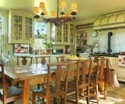 Ceiling lamps in vintage style and wooden furniture – Italian kitchen interior