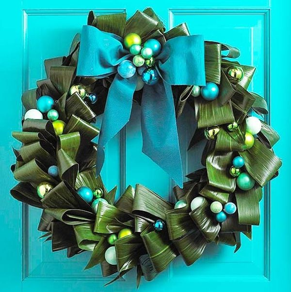 Christmas wreath from decorative paper on the door