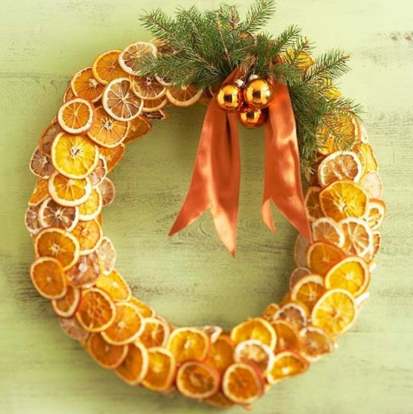 Christmas wreath made of spruce and citrus with Christmas balls