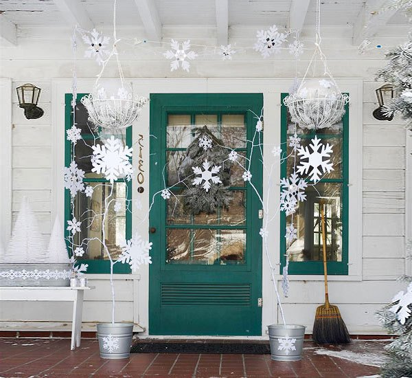 Paper snowflakes is the most simple way to decorate a door for New Year