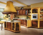 Italian kitchen – orange and yellow colors in the interior decoration