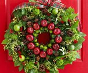 Wreath decorated with pine cones, lime and apples