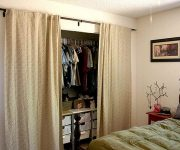 Closets with curtains for doors