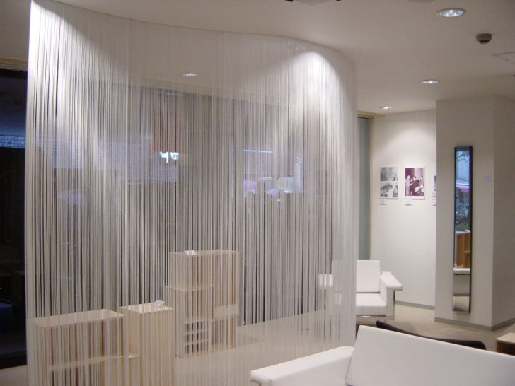 With the help of decorative curtains you can visually expand the space of a room