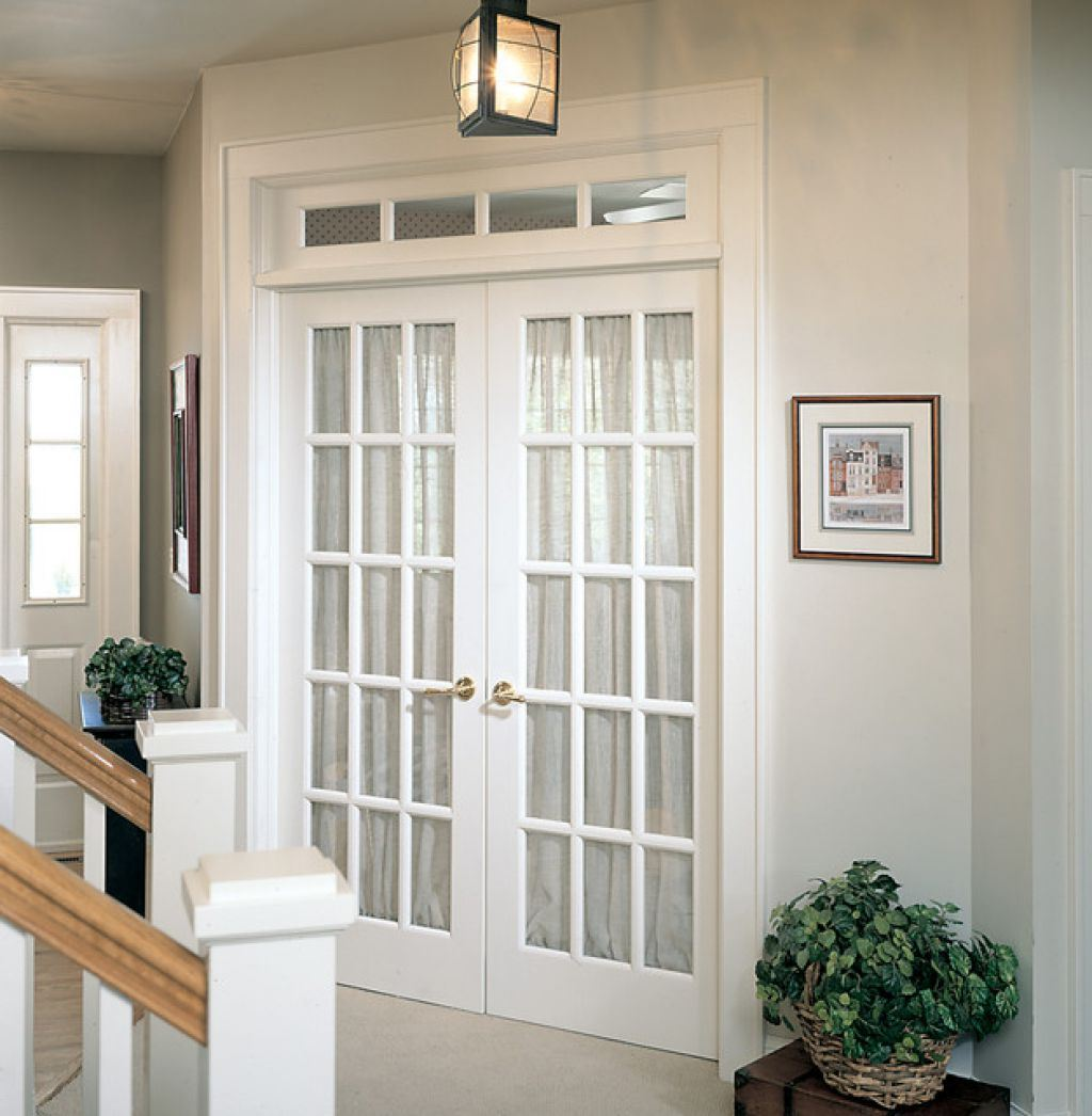 & White interior french doors with glass